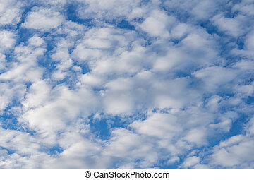 Cirrocumulus clouds against blue sky for backgrounds concept