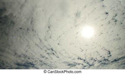 cirrocumulus clouds and sun - Cirrocumulus clouds in the...