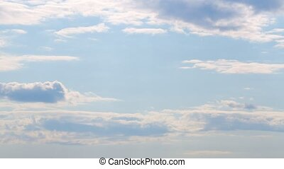 Cirrocumulus clouds in motion. Cloudscape moved on daylight in tropical summer sunlight. Time lapse.