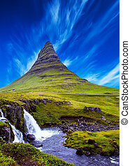 Cirrus clouds in the blue sky - The famous mountain in...