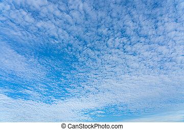 Cirrus white clouds on the wide blue sky for background