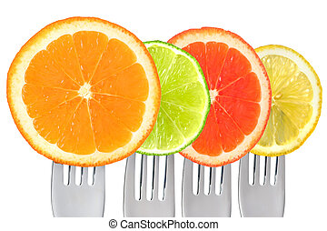 cirtus fruit on forks isolated against white background
