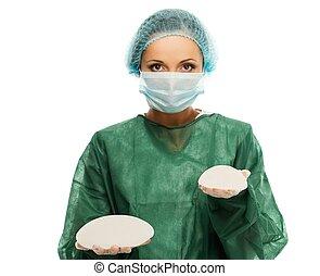 cirujano plástico, mujer, en, gorra, y, máscara, tenencia,...