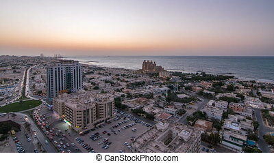 Citiscape of Ajman and Sharjah day to night timelapse from top