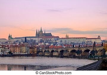 Citiscape view of Prague castle and Charles bridge at sunrise
