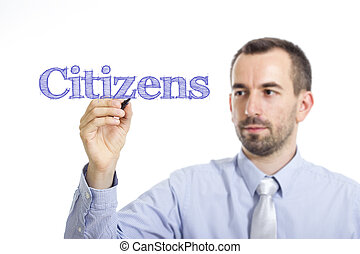 Citizens - Young businessman writing blue text on transparent surface