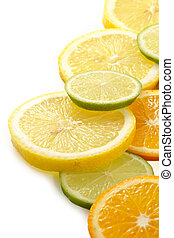 Citron allsorts-lime, lemon, tangerine cut on slices and laid out for preparation of cocktails and soft drinks