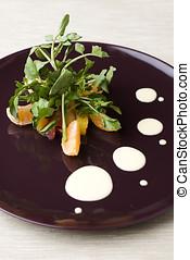 Citrus arugula salad with orange mayonaise dressing