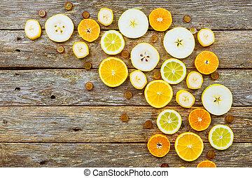 Citrus background. Citrus fruits. On wooden background.