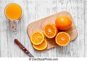 Citrus concept. Oranges and fresh juice on wooden table background top view