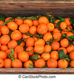 Citrus. Fresh oranges in a box on display at a farmers market or store. Harvest concept. Top view