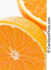 Close up of halved orange against white background.
