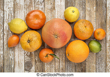 citrus fruit collection on weathered wood
