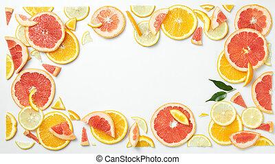 citrus fruit frame of slices isolated on white background