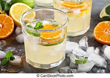 Citrus fruit lemonade in glasses