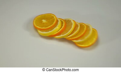 Citrus Fruit Slices Falling on the White Surface.
