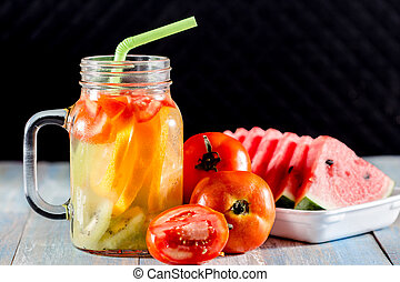 citrus fruits and kiwi, tomato in p