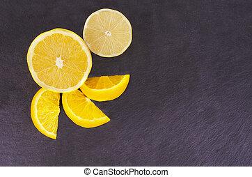 Citrus fruits on slate