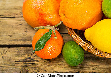 Citrus fruits on wooden background