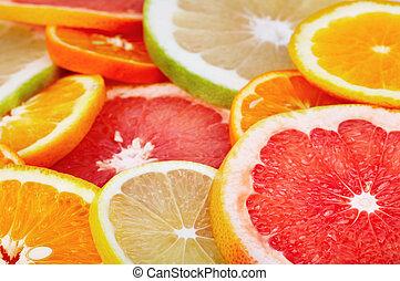 Sliced citrus fruits background closeup