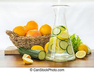 citrus lemonade in glass jug on table