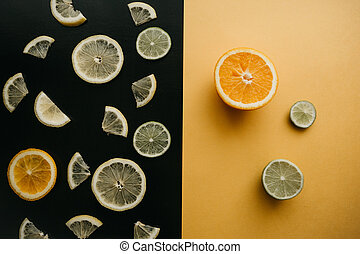 Citrus on a black and yellow background.