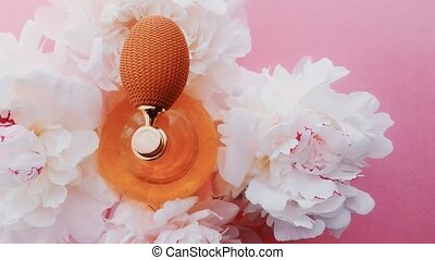 Citrus perfume bottle with peony flowers, chic fragrance scent as luxury cosmetic, fashion and beauty product background, stock footage