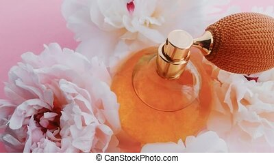 Citrus perfume bottle with peony flowers, chic fragrance scent as luxury cosmetic, fashion and beauty product backgrounds