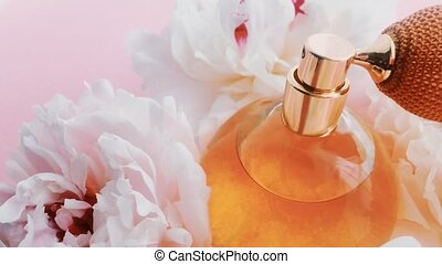 Citrus perfume bottle with peony flowers, chic fragrance ...