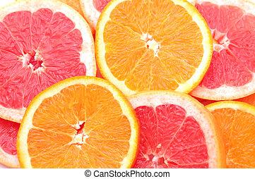 Citrus slices background - orange and grapefruit