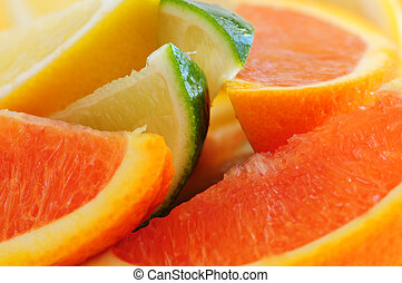 Citrus wedges - Wedges of assorted citrus fruits lemon...