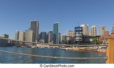 A wide shot of a city and ters with a boat's rope.