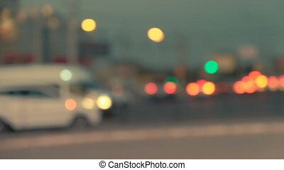 City at night background with cars. Out of focus background with blurry unfocused city lights. Pan across city blur background. Moving bokeh circles of night traffic.