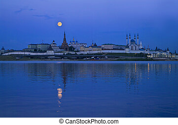 city at night with full moon