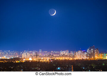 City at night with new moon