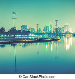 City at night with reflection of skyline,Vintage tone