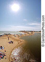 City beach with vacationers. Berdyansk, Ukraine - Berdyansk,...