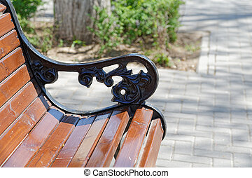 City bench closeup summer day