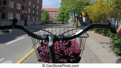 City bike ride POV - Riding a bike throught the urban ...