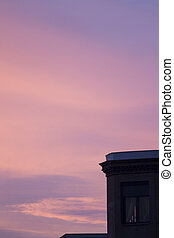 City building roof silhouette and dusk sunset sky