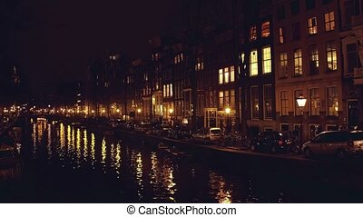 City canal at night. Amsterdam, Netherlands - City canal at...