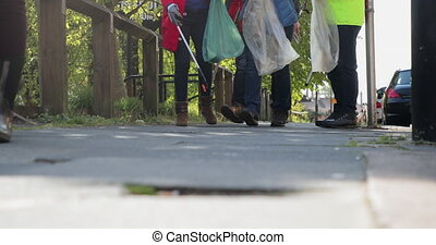 City Cleaners Walking - A low angle front view shot of a ...