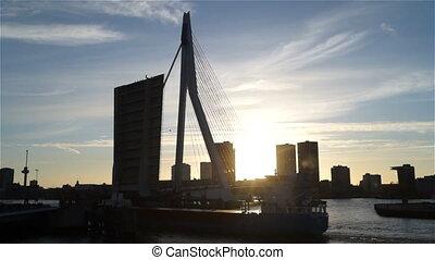 City clouds ship river sky sun bridge