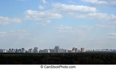 City clouds timelapse - An urban landscape with clouds...