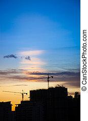 City construction at sunset