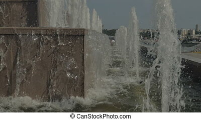 City fountain close up. Spray water