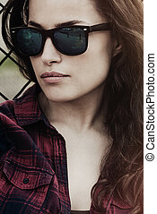 city girl portrait with sunglasses outdoor