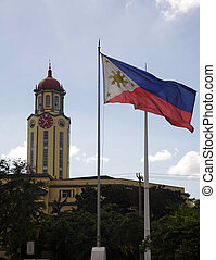 City hall. - Clock tower and flag at of the city hall. In...