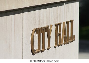 City Hall Sign - Sign that reads city hall on the side of a...