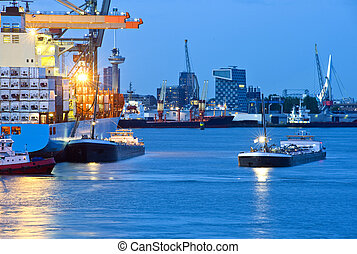 City harbor - Huge container ships mooring off, with several...